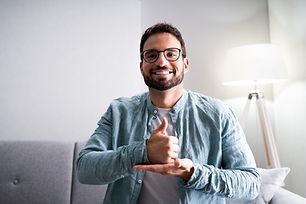 Adult Learning Sign Language For Deaf Disabled.jpg