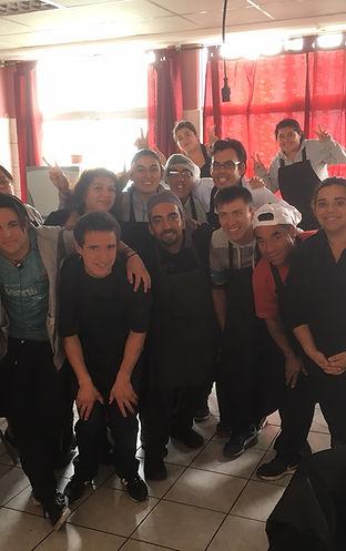 Grupo de personas con uniforme de cocina