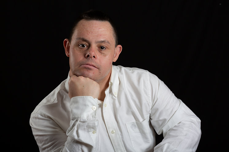 a happy man with down syndrome in photo studio on black background.jpg