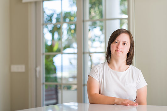 Down syndrome woman at home with serious