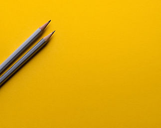 grey pencils on yellow background_edited