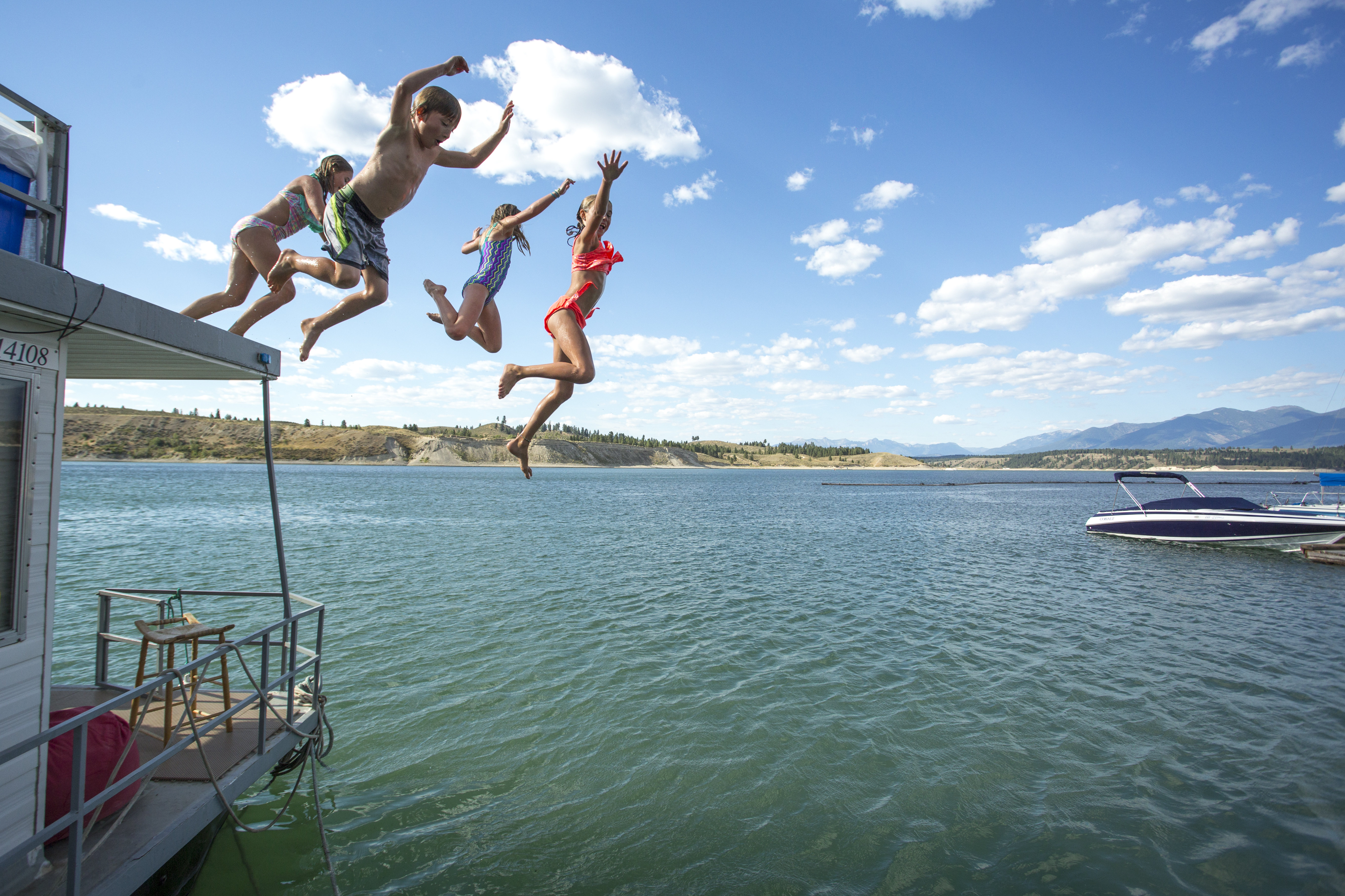 MK_Kids jumping off boat-13.jpg
