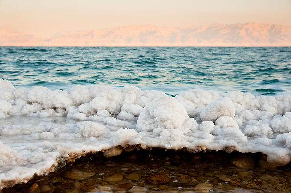 Salt-encrusted rocks along the shores of