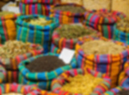 Various spices in colorful sacks on sale