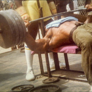 Wide Colar-to-Colar bench press.  4 sets x 25 reps of 415 pounds.