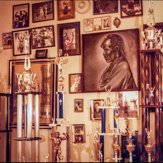 1985. Craig's trophy room with pictures on the wall.