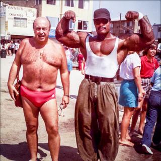 Craig posing next to friend and sponsor Paco Arcie.