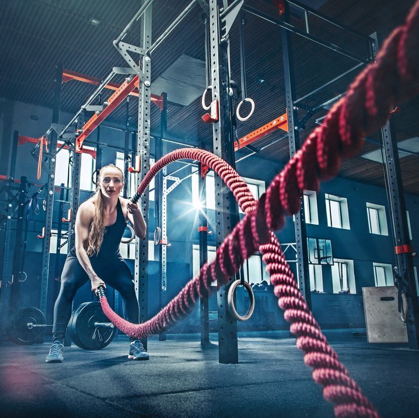 Woman with battle rope battle ropes exer