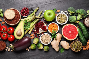 Fresh vegetables, fruits and seeds on black table, flat lay.jpg