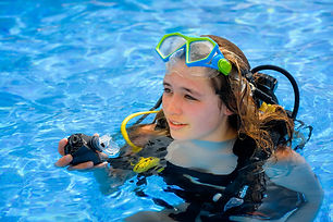 beautiful young woman taking a scuba div