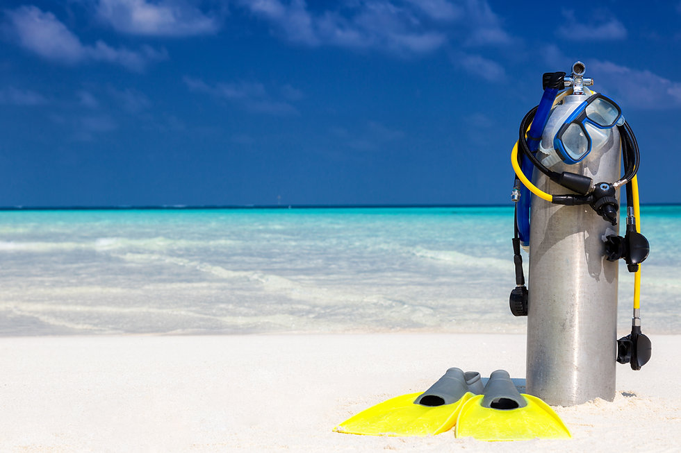 Scuba diving equipment on a tropical bea