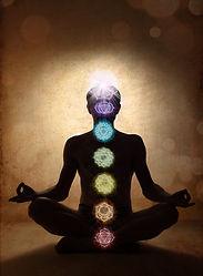 Yoga man in lotus pose with chakra symbo