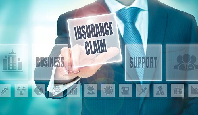 A businessman pressing an Insurance Clai