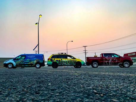 fleet of vehilcles sunset.jpg