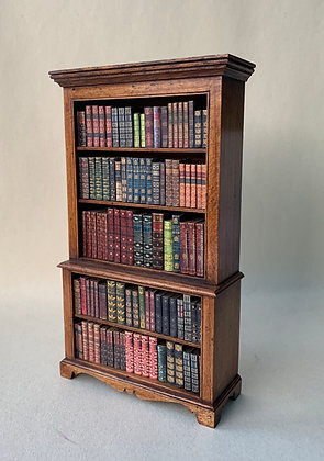 Open Bookcase with Books by Ellie de Lacy