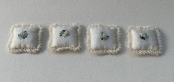 Set of 4 small silk cushions by Lyn Johnson