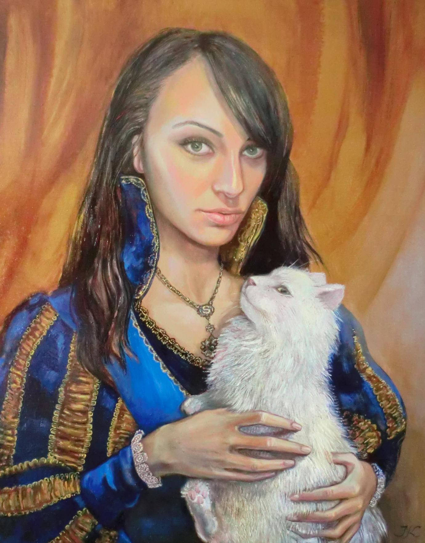 Meitene ar kaķi