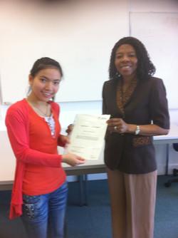 Ngozi Presenting a Certificate
