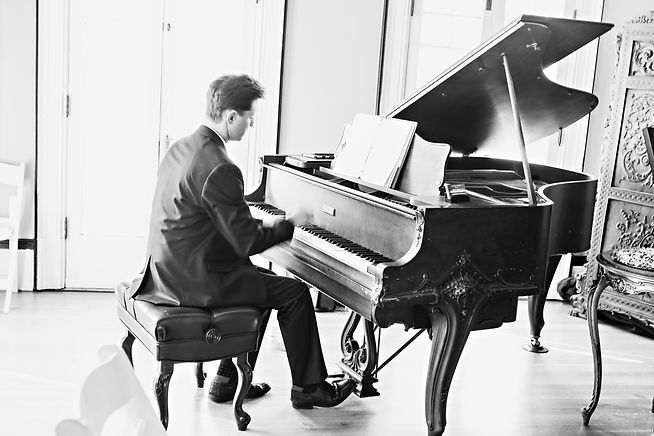 Tanner at piano, full length, bw.jpg