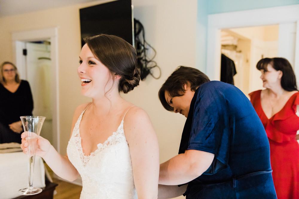 Bride putting on wedding dress Jessica Hilton Portland Oregon Wedding Photographer