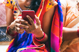Indian woman using mobile phone.jpg