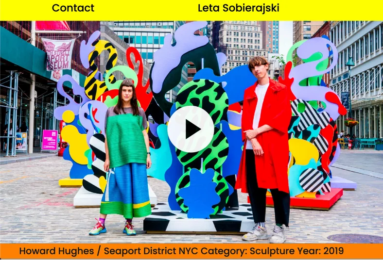 Image of designers Leta Sobierajski and Wade Jeffree standing in front of a large scale series of colorful sculptures titled 'Seaport District Sea Sculptures' in New York City.