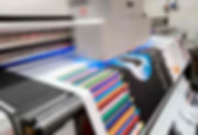 large format printing machine printing a colorful banner