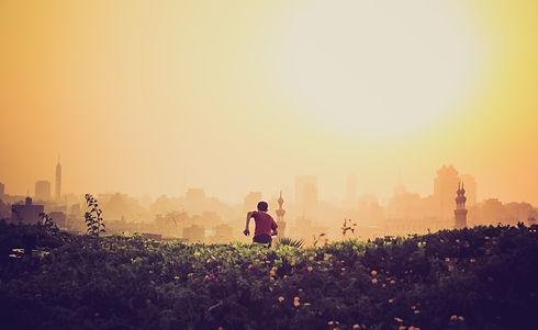 person_boy_running_cityscape_skyline_blu