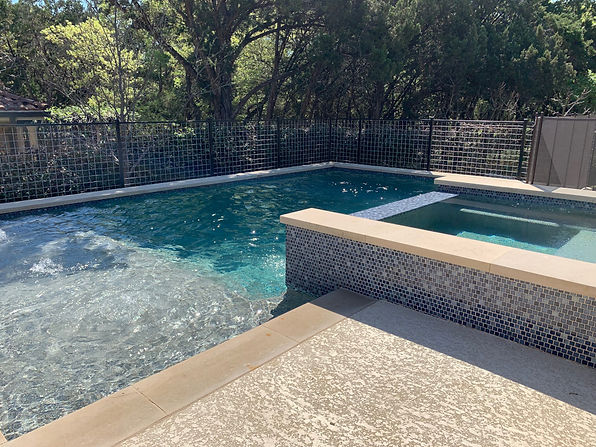 Installed trellis around pool to protect kids from falling off raised wall, removed stone finish on patio and refinished to update look, cleaned up yard.
