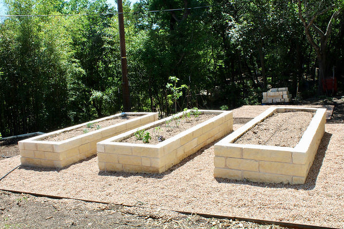 This client came to us with a design by another designer as well as a bamboo and slope problem. We decided to remove the bamboo from the back yard and correct the slope with a retaining wall. Next, we installed three limestone raised beds for veggie gardening, several fruit trees lining the property line and gravel areas around the veggie garden. We addressed some flooding issues around the entry by excavating for positive water flow and allowing for a rain garden.