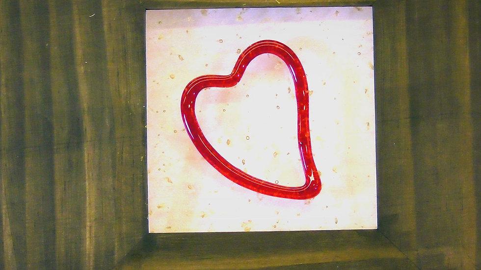 Tavla med rött hjärta