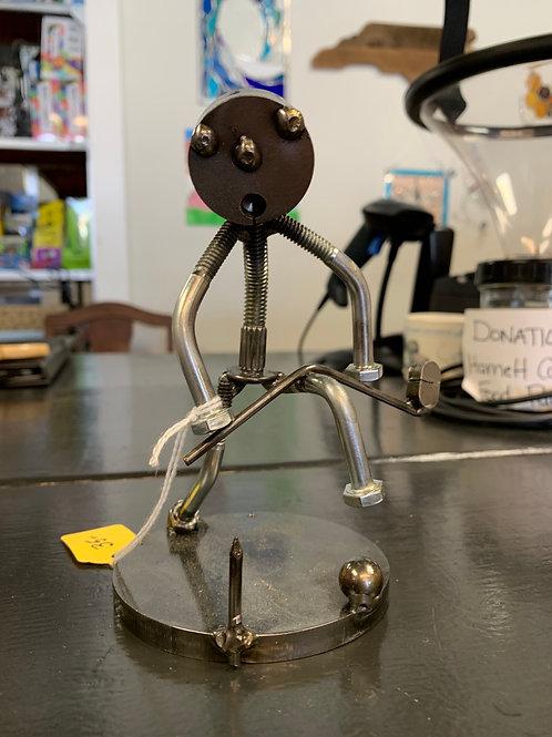 Mad golfer metal sculpture