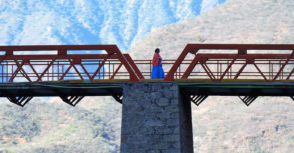 Taurahumara woman crossing the new Batopilas Bridge, Mexico