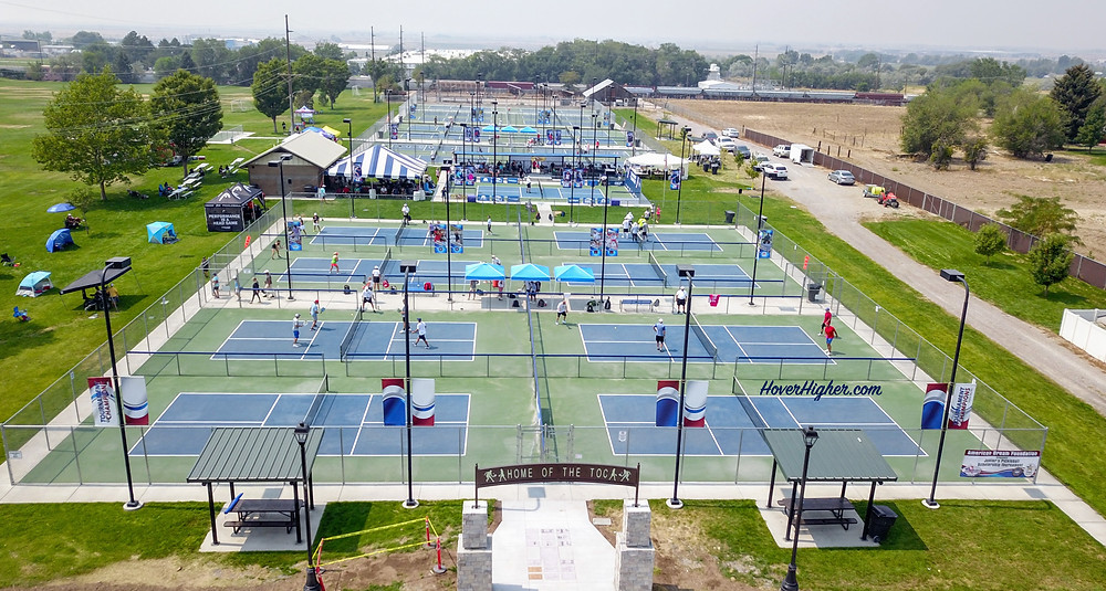 Rees Pioneer Park Tournament of Champions Pickleball Courts 2021 in Brigham City drone shot aerial view of entry HoverHigher.com