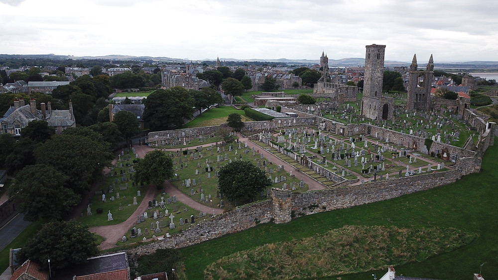 St. Andrews Cathedral, graveyard church Scotland drone photography aerial view hoverhigher