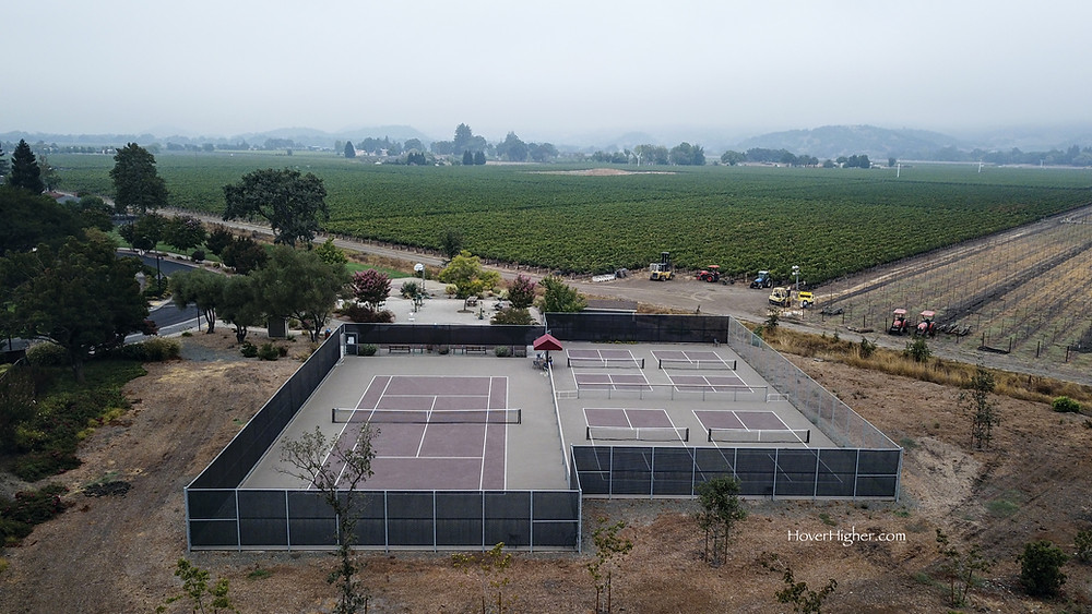 Drone view shot of Vineyard Park Pickleball Courts in Yountville, CA Smokey area from California Fires
