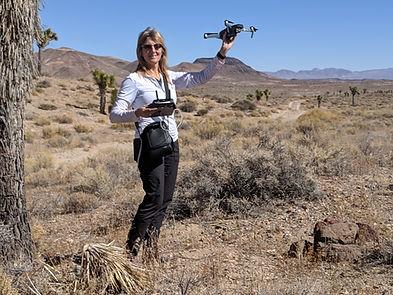 Bonnie with drone in desert.jpg
