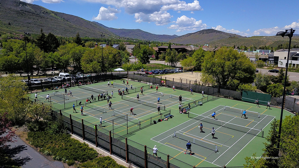 Many people playing pickleball on Memorial Day 2021 at City Park tennis court in Park City, Utah UT