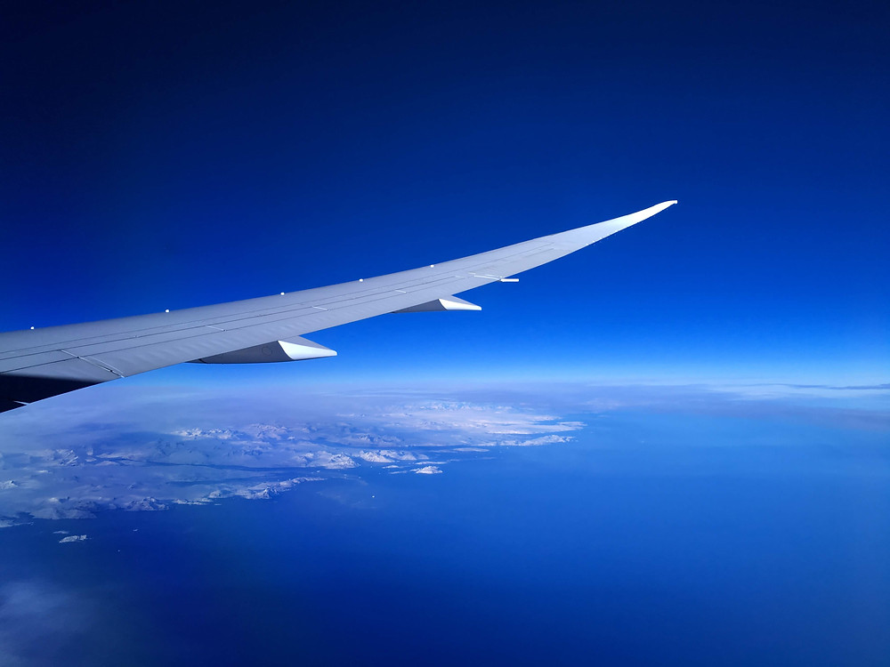 Plane photo in flight ocean greenland
