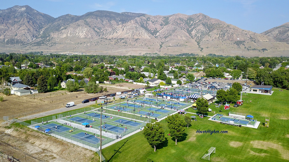 Rees Pioneer Park Tournament of Champions Pickleball Courts 2021 in Brigham City HoverHigher.com drone shot aerial view with mountains in background