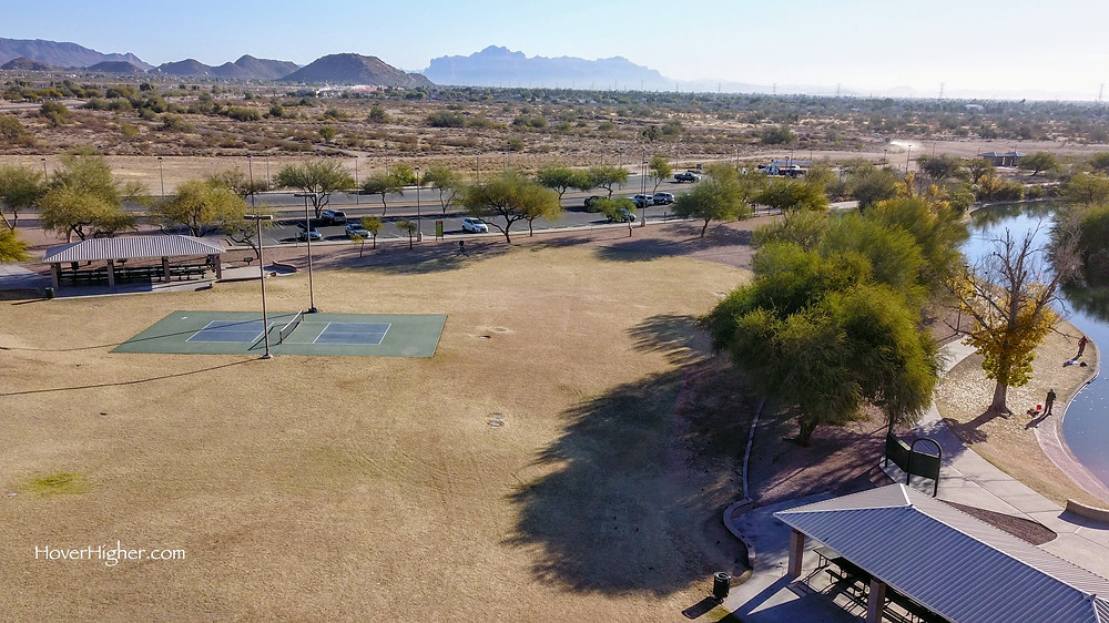 pickleball court in Mesa, Arizona near small lake and picnic area gazebos with mountains in the background
