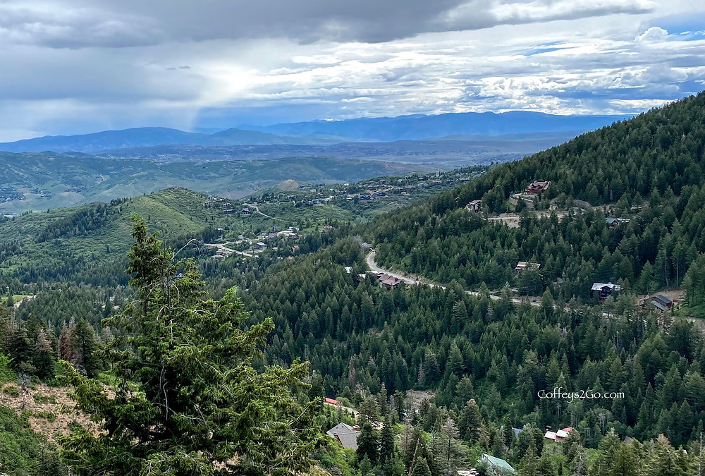 Park City Utah hiking trail with gorgeous clouds up above Kimball Junction