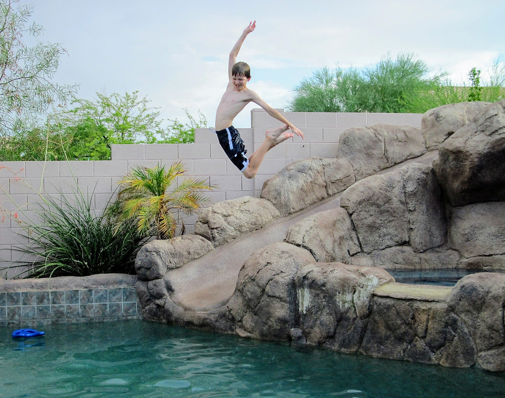 nathan-jumping-in-pool-cropped