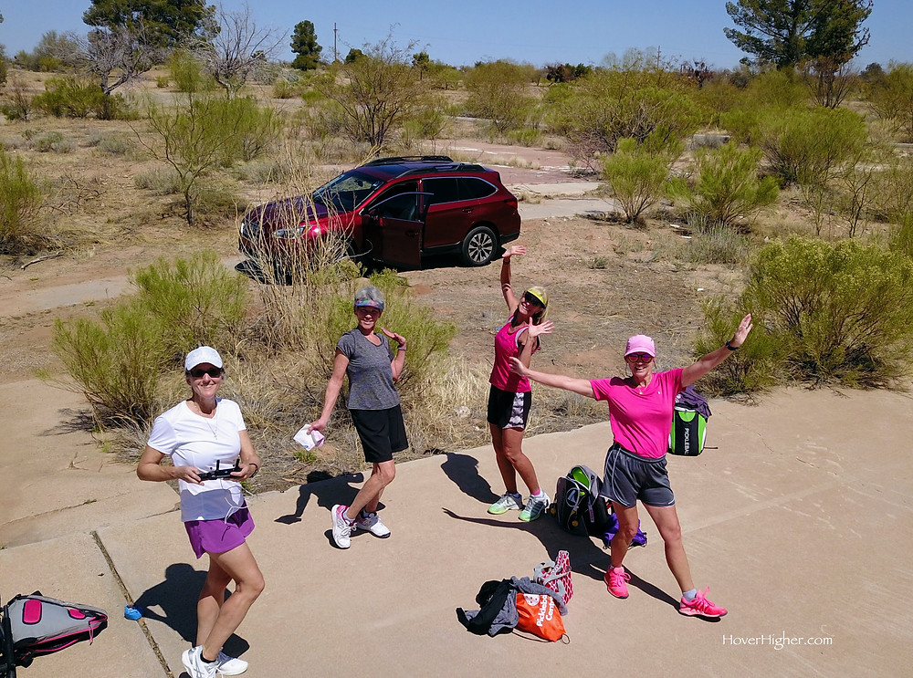 Aerial view of four women on a secret pickleball court in the desert in Arizona