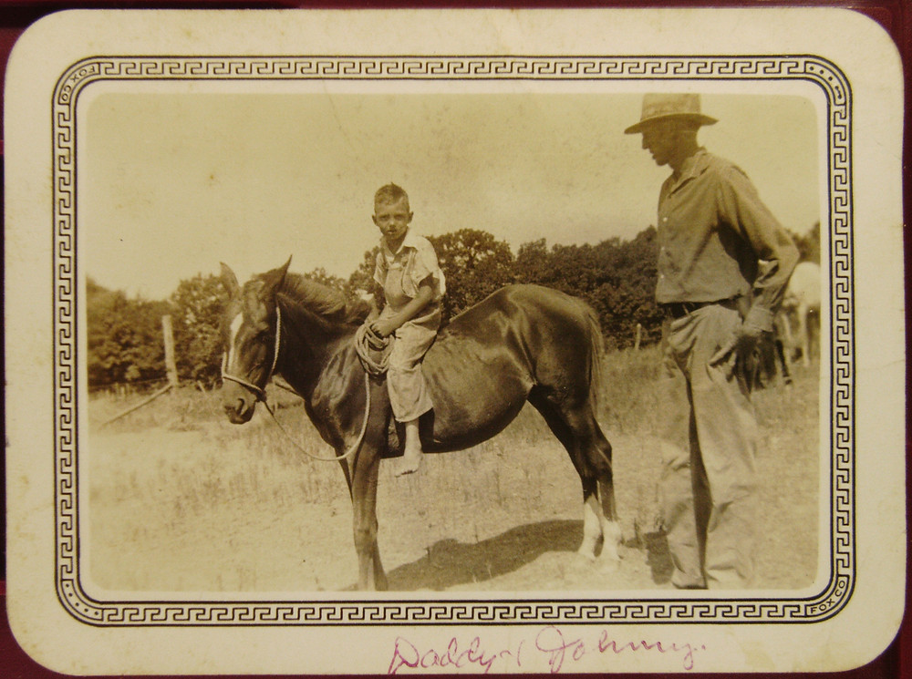 Historic photo Young boy on small horse being watched by his father in East Texas