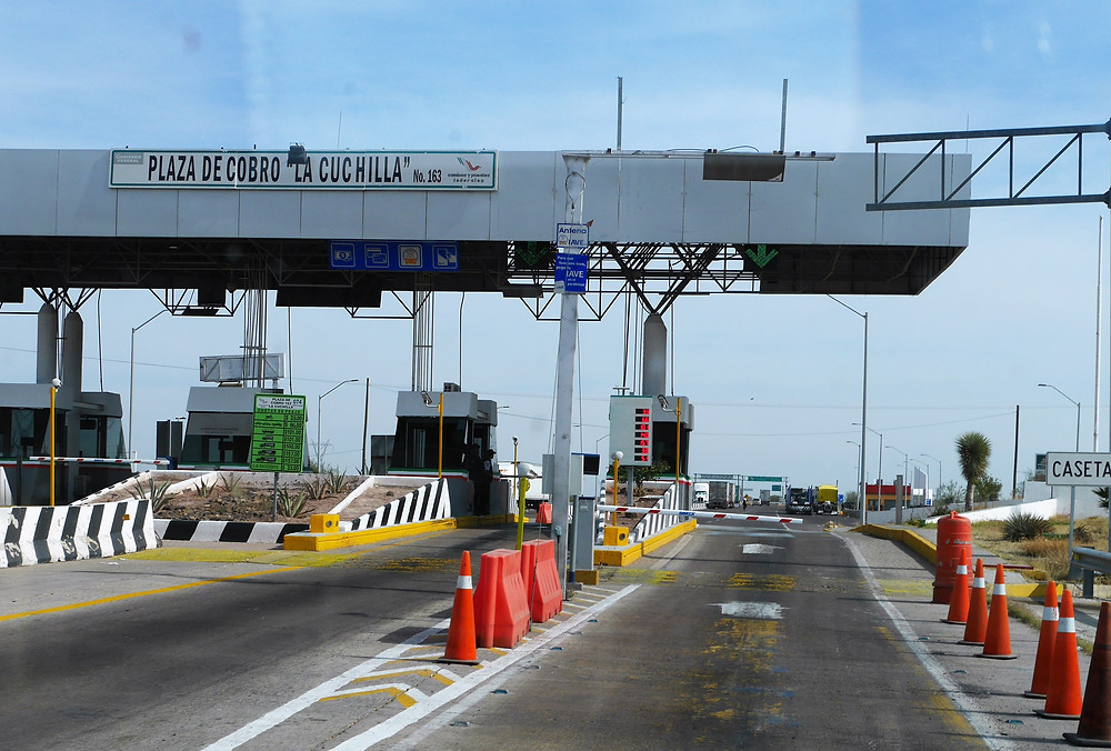 toll booth along road in chihuahua, mexico