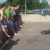 Lead Instructor Jason Benjamin teaching candidates from class 1702 how to use Rescue Swimmer PPE.