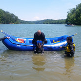Instructor Benjamin demonstrating how to pull a victim into the raft.