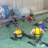 Instructor Benjamin addressing Rescue Swimmer candidates from class 1702 on the first day of training.