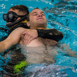 A rescue swimmer candidate from class 1701 practicing a buddy tow.